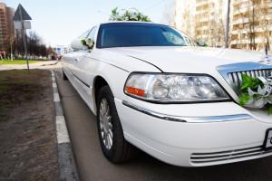 White wedding limousine on city street outdoors